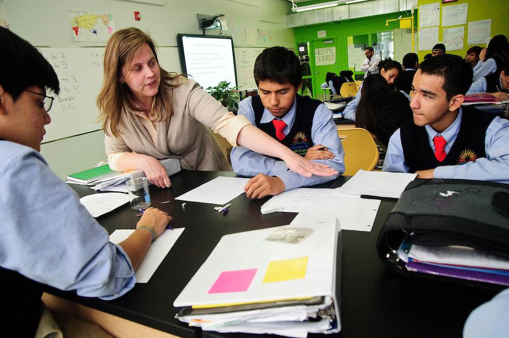 Instituto Health Sciences Career Academy instructor Amanda Lovall-Cole works with students during a freshman science class. The school is operated by Instituto Progresso Latino, a Chicago-based not-for-profit incorporated in 1977 to help Latino immigrants adjust to American life through English lessons, education, and employment services. 11/17/11