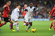 Nathan Dyer manages to retain the ball for Swansea City.<br /> Barclays Premier League match, Cardiff city v Swansea city at the Cardiff city stadium in Cardiff, South Wales on Sunday 3rd Nov 2013. pic by Phil Rees, Andrew Orchard sports photography,