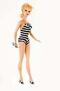 1959 Teenage Fashion Model Barbie® doll introduced at the New York Toy Fair on March 9, 1959 and featuring the famous black and white bathing suit.