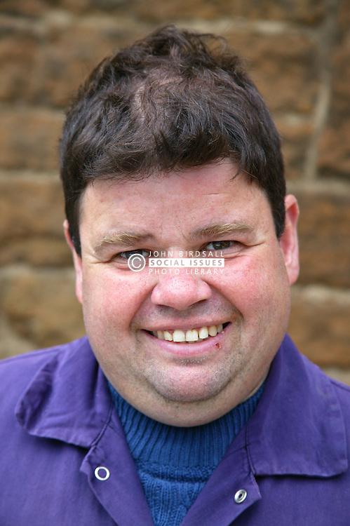 Portrait of man with learning disability smiling; at Brook Farm; Linby,
