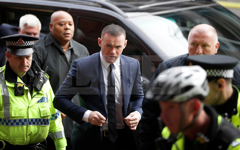 © Licensed to London News Pictures . 18/09/2017. Stockport, UK. Press, security and police outside of the court where Everton footballer Wayne Rooney is due to arrive at Stockport Magistrates Court where he faces a drink-driving charge . The former England and Manchester United captain was arrested by police whilst driving in Wilmslow in Cheshire during the early hours of 1st September . Photo credit: Joel Goodman/LNP