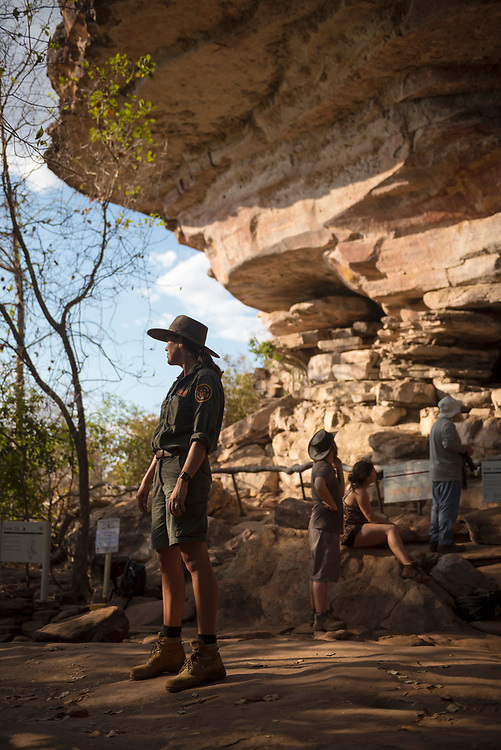 Kakadu National Park, Australia - September 5, 2017: Phoebe Reeve, at work for Parks Australia at Kakadu National Park in Australia's Northern Territory, leads a guided walk through centuries-old rock art and on toward Ubirr lookout.