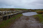 Clapper Bridge, Mayo, built by a John Alexander, a member of a Protestant colony in the 1840s, known as the Society for the Protection of Rights of Conscience. The colony sought to convert Catholics during the famine through the use of soup kitchens. This design of bridge has been in use as far back as prehistoric times in Britain, but not so common in Ireland.