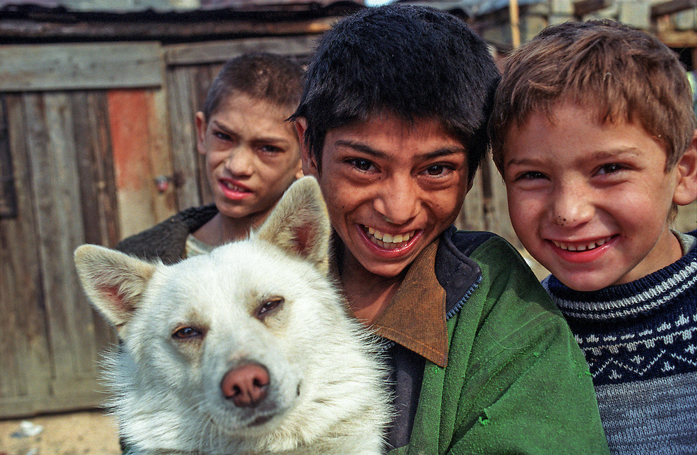 Roma children with a dog in Jarovnice - the biggest Roma Settlement in Eastern Slovakia.