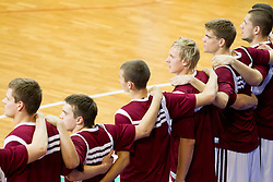 Players of Latvia listening to the national anthem during basketball match between National teams of Latvia and Slovenia in Qualifying Round of U20 Men European Championship Slovenia 2012, on July 16, 2012 in Domzale, Slovenia. (Photo by Vid Ponikvar / Sportida.com)