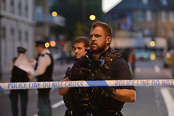 Armed police officers man a cordon in Finsbury Park, north London, where one man has died, eight people taken to hospital and a person arrested after a van struck pedestrians.
