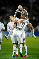 FOOTBALL - UEFA CHAMPIONS LEAGUE 2009/2010 - GROUP C - OLYMPIQUE MARSEILLE v REAL MADRID - 8/12/2009 - PHOTO FRANCK FAUGERE / DPPI - CRISTIANO RONALDO (REAL) CELEBRATES HIS GOAL WITH KARIME BENZEMA AND PEPE