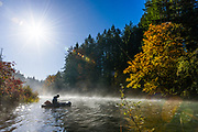 David Page ties on a fly during a foggy fall morning. Vancouver Island, BC