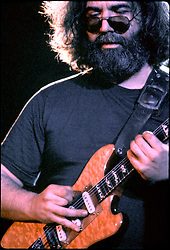 Jerry Garcia, concentrating, playing guitar. With the Grateful Dead in Concert at the Huntington Civic Center, Huntington West Virginia on 16 April 1978. Image No. 78C15-05