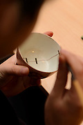 "Repairing a teacup using the technique of kintsugi. Kintsugi event, Daiwa Anglo-Japanese Foundation, London, UK, January 24, 2014. Kintsugi literally means ""joining with gold"": a technique to piece together broken pottery or glass with lacquer, rice-glue and gold."