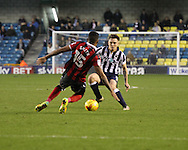Ben Thompson of Millwall and Sid Nelson of Shrewsbury Town during the Sky Bet League 1 match at The Den, London<br /> Picture by Richard Brooks/Focus Images Ltd 07947656233<br /> 10/12/2016