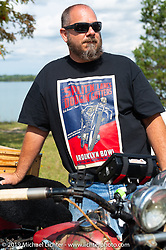Richard Kaylor lined up for the panorama portrait in Aune Osborne Park in Sault Sainte Marie, the site of the official start of the Cross Country Chase motorcycle endurance run from Sault Sainte Marie, MI to Key West, FL. (for vintage bikes from 1930-1948). Thursday, September 5, 2019. Photography ©2019 Michael Lichter.