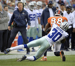 September 17, 2017 - Denver, CO, USA - Dallas Cowboys cornerback Anthony Brown (30) tries to bring down Denver Broncos wide receiver Demaryius Thomas (88) during the first quarter on Sunday, Sept. 17, 2017 at Sports Authority Field at Mile High in Denver, Colo. (Credit Image: © Max Faulkner/TNS via ZUMA Wire)