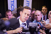"22 FEBRUARY 2012 - MESA, AZ:   Senator RICK SANTORUM talks to reporters in the ""Spin Room"" to talk about his performance in the Arizona Republican Presidential Debate in Mesa, AZ, Wednesday. The candidates and their representatives visited the ""Spin Room"" after the debate to discuss how well their candidates did in the two hour debate, the last one before the Arizona and Michigan primaries next week and ""Super Tuesday"" on March 6.     PHOTO BY JACK KURTZ"