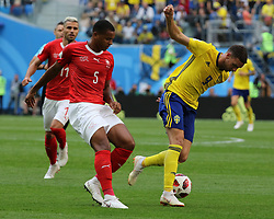 July 3, 2018 - Russia - July 03, 2018, St. Petersburg, FIFA World Cup 2018 Football, the playoff round. Football match of Sweden - Switzerland at the stadium of St. Petersburg. Player of the national team.. Marcus Berg; Manuel Akandji. (Credit Image: © Russian Look via ZUMA Wire)