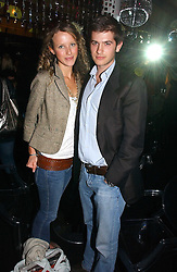 KATE MELHUISH and JACK FREUD at the launch party for the fashion label Javovich-Hawk held at the Fifth Floor Cafe, Harvey Nichols, Knightsbridge, London on 27th April 2006.<br />