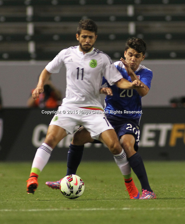 United States' Oscar Sorto #20 and Mexico's Daniel Hern¡ndez Trejo #11 fight for a ball during a men's national team international friendly match, April 22, 2015, at StubHub Center in Carson, California. United States won 3-0. (Photo by Ringo Chiu/PHOTOFORMULA.com)