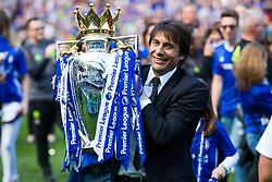 Manager Antonio Conte holds the trophy as Chelsea celebrate winning the 2016/17 Premier League - Rogan Thomson/JMP - 21/05/2017 - FOOTBALL - Stamford Bridge - London, England - Chelsea v Sunderland - Premier League..
