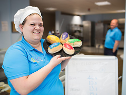 """© Licensed to London News Pictures . 04/06/2014 . Newark , Nottinghamshire , UK . ALG Bakery in Newark are selling """" by-election buns """" with coloured icing to represent the parties in the campaign for the seat in tomorrow's (Thursday 4th June 2014) by-election . Teresa Flowerdew (l) and her father Les Flowerdew's (r) unscientific sales survey shows blue for Conservative are currently polling at 46.9 percent , with purple for UKIP in 2nd place at 15.2 percent , yellow for Lib Dems at 13.1 percent and red for Labour at 10.3 percent . Photo credit : Joel Goodman/LNP"""