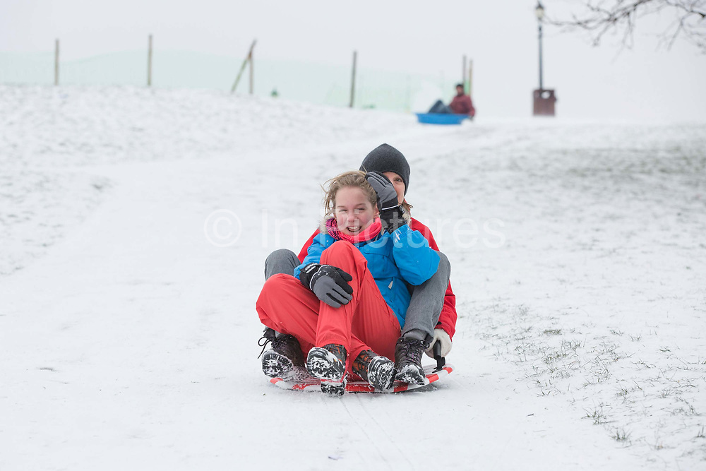 Londoners enjoy sledging at Primrose Hill following a second day of snow on the 1st March 2018 in North London, United Kingdom. A cold front from Russia brings snow and freezing conditions across the UK, dubbed the 'Beast from the East'.