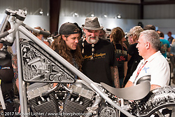 Custom builder Brad Gregory talks about his bike with Reed Holmes at the Old Iron - Young Blood exhibition media and industry reception in the Motorcycles as Art gallery at the Buffalo Chip during the annual Sturgis Black Hills Motorcycle Rally. Sturgis, SD. USA. Sunday August 6, 2017. Photography ©2017 Michael Lichter.