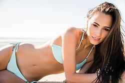 Young Woman on Beach Wearing Bikini