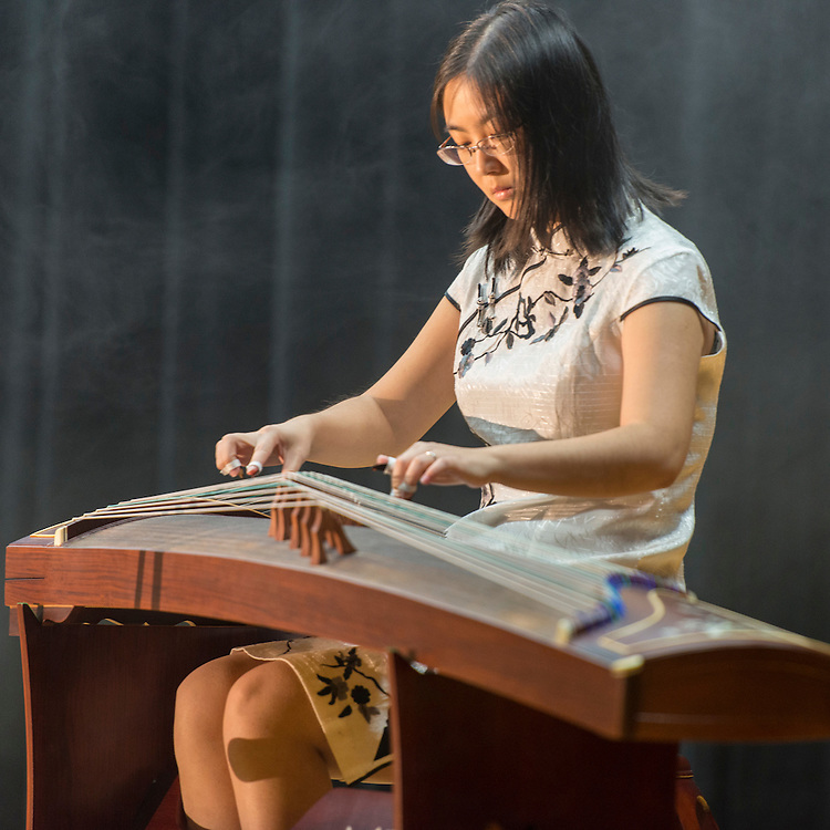 Westside High School instructor Bo Sun plays a Guzheng during a district wide celebration of the Chinese New Year at Sharpstown International School, February 22, 2014.