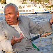 Felucca worker talks about his hopes for the future and his vision of a new Egypt while sailing his boat on the River Nile in Cairo.