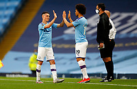 Football - 2019 / 2020 Premier League - Manchester City vs. Burnley<br /> <br /> Leroy Sane of Manchester City replaces Phil Foden of Manchester City  at the Etihad Stadium. <br /> <br /> <br /> COLORSPORT/LYNNE CAMERON