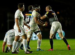 Harlequins' Mike Brown (left) and Exeter's Don Armand clash during the Aviva Premiership match at Twickenham Stoop, London.