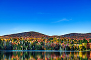 Scenic Colton Pond and autumn foliage, Killington, Vermont, USA.