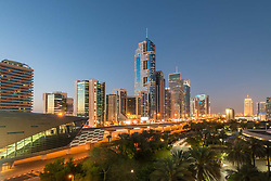 Modern skyscrapers at night along Sheikh Zayed Road in Dubai United Arab Emirates