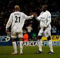 Fotball<br /> England 2004/2005<br /> Foto: SBI/Digitalsport<br /> NORWAY ONLY<br /> <br /> Bolton Wanderers v Tottenham Hotspurs, Barclays Premiership, 01/02/2005.<br /> Bolton's El Hadji Diouf (L) and best friend Khalilou Fadiga celebrate after they combine to set up Kevin Davies for Bolton's third goal.