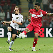 Turkey's Colin Kazım RICHARDS (R) and Germany's Benedikt HOWEDES (L) during their UEFA EURO 2012 Qualifying round Group A matchday 19 soccer match Turkey betwen Germany at TT Arena in Istanbul October 7, 2011. Photo by TURKPIX