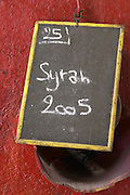 Syrah 2005. Chateau Villerambert-Julien near Caunes-Minervois. Minervois. Languedoc. Painted steel vats. Concrete fermentation and storage vats. Sign on tank. France. Europe.
