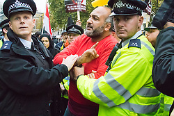 Whitehall, London, November 5th 2015. Pro Sisi demonstrators and counter protesters from UK Egyptian and human rights groups shout each other down outside Downing Street ahead of Egypt's President Abdel Fatah al-Sisi visiting Prime Minister David Cameron at No. 10. PICTURED: A pro-Morsi supporter is arrested by police.