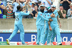England's Ben Stokes (right) celebrates the catch of South Africa's Andile Phehlukwayo with team-mates during the ICC Cricket World Cup group stage match at The Oval, London.