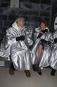 John Walsh, Lady Sally Oliver. Opening of the Absolut Icebar. Heddon St. London. 29 September 2005. ONE TIME USE ONLY - DO NOT ARCHIVE © Copyright Photograph by Dafydd Jones 66 Stockwell Park Rd. London SW9 0DA Tel 020 7733 0108 www.dafjones.com