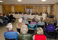 Liz Tentarelli from the League of Women Voters moderates the candidates forum for Meredith Select Board on Thursday evening at the Meredith Community Center. Candidates (l-r) Bev Lapham, Jr, David Lund Bennett, Sr, L. Michael Hatch, Jonathan James, Ray A. Moritz, Michael J. Pelczar and Roland Tichy.  Not present Rosemary Kiernan Landry.  (Karen Bobotas/for the Laconia Daily Sun)