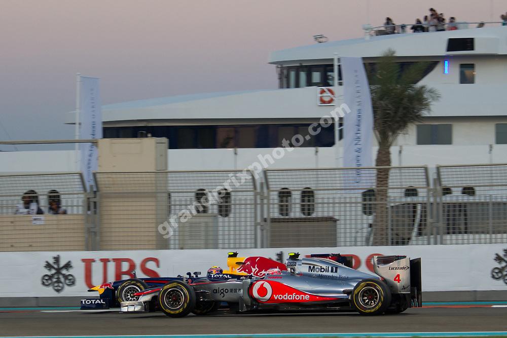 Mark Webber (Red Bull-Renault) leading Jenson Button (McLaren-Mercedes in the 2011 Abu Dhabi Grand Prix at Yas Marina circuit. Photo Grand Prix Photo