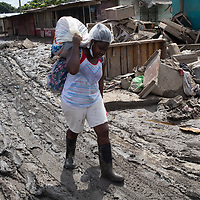 A woman carries a bag as she walks through mud after hurricane Eta in La Planeta, San Pedro Sula, Honduras.<br /> <br /> Hurricanes Eta and Iota hit hard on the north coast of Honduras, leaving some areas flooded for three weeks, destroying people's furniture, belongings, vehicles and houses as well as standing crops.