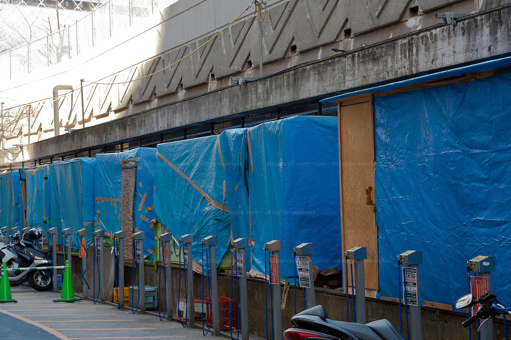 Shelters constructed by homeless people alongside Miyashita Park after their eviction from the park to allow for its redevelopment as the Nike Park. Shibuya, Tokyo, Japan Friday, March 4th 2011