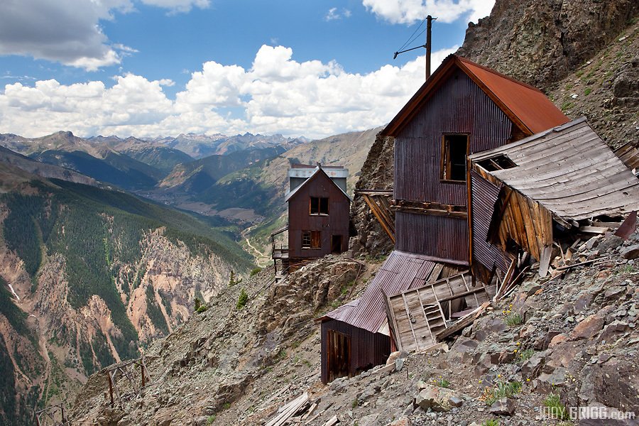 Perched high up on a rocky slope some 2,250ft high than the mine is the old tram house (right) and boarding house (left) of the Old Hundred Mine at Howardsville near Silverton, Colorado.