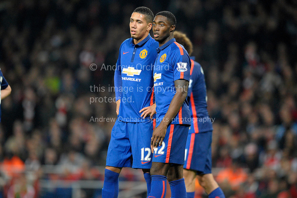 Tyler Blackett of Manchester United and Chris Smalling of Manchester United watching on.Barclays Premier league match, Arsenal v Manchester Utd at the Emirates Stadium in London on Saturday 22nd November 2014.<br /> pic by John Patrick Fletcher, Andrew Orchard sports photography.
