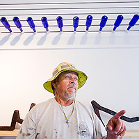 101212       Cable Hoover<br /> <br /> Gallup artist Jacques Tixier takes a break while hanging a show Oct. 12, 2012 at Art 123 Gallery in downtown Gallup.