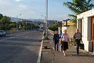 Stepanakert, Nagorno-Karabakh - September 21, 2016: Pedestrians walk late in the afternoon in Stepanakert, capital of the disputed region of Nagorno Karabakh, locally known as the Republic of Artsakh.<br /> <br /> (September 21, 2016)