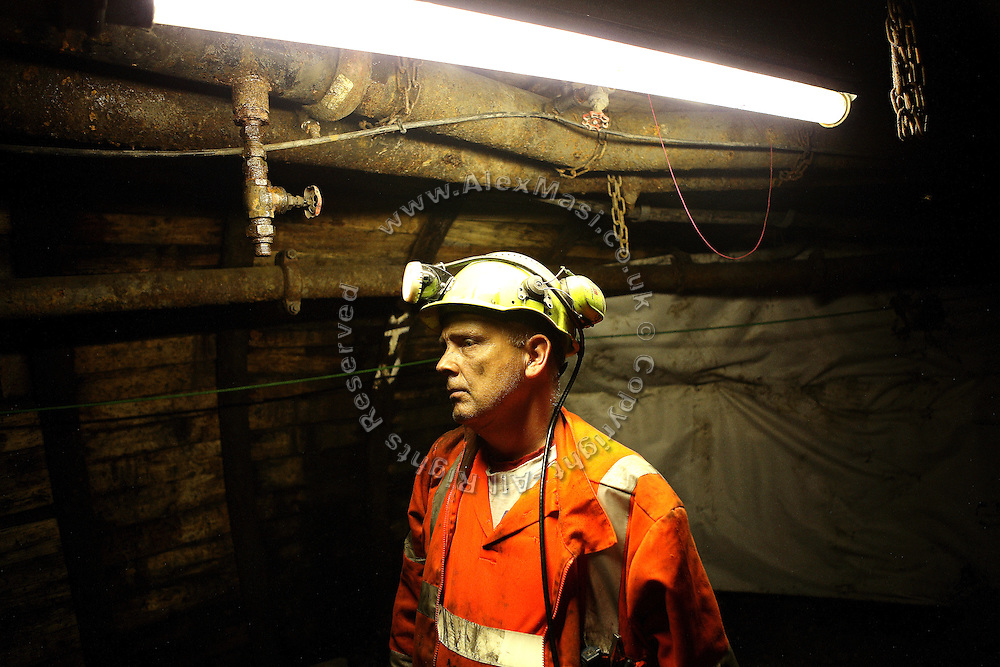 A Welsh miner stands under a dim light inside Unity Mine, on Tuesday, June 19, 2007, in Cwmgwrach, Vale of Neath, South Wales. The time is ripe again for an unexpected revival of the coal industry in the Vale of Neath due to the increasing prize and diminishing reserves of oil and gas, the uncertainties of renewable energy sources, and the technological advancement in producing energy from coal while limiting emissions of pollutants, has created the basis for valuable investment opportunities and a possible alternative to the latest energy crisis. Unity Mine, in particular, has started a pioneering effort to revive the coal industry in the area, reopening after more than 8 years with the intent of exploiting the large resources still buried underground. Coal could be then answer to both, access to cheaper and paradoxically greener energy and a better and safer choice than nuclear energy as a major supply for the decades to come. It is estimated that coal reserves in Wales amount to over 250 million tonnes, or the equivalent of at least 50 years of energy supply, while the worldwide total coal could last for over 200 years as a viable resource compared to only a few decades of oil and natural gas.