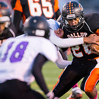 100413       Cable Hoover<br /> <br /> Gallup Bengal James Henry (26) tries to push past the Kirtland Central Broncos Friday at Public School Stadium.