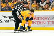 Nashville Predators defenseman Dan Hamhuis (5) skates off the ice after taking a puck to the face during a game between the Pittsburgh Penguins and Nashville Predators at Bridgestone Arena in Nashville, TN December 27, 2019