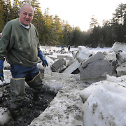 2/17/11 -- HARPSWELL, Maine. Michael Bernier of Harpswell takes a short break from digging clams in Quahog Bay on Thursday afternoon. He and a small group of diggers cut through the ice at low water with chain saws to dig here. <br />